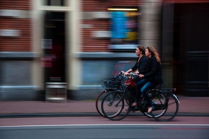 image of two girls cycling